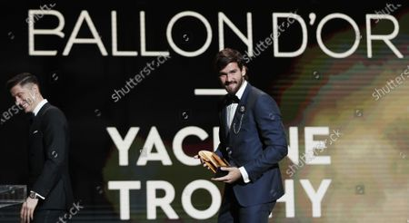 Liverpool goalkeeper Alisson Becker wins the Yashin Trophy as best goalkeeper during the Ballon d'Or ceremony at Theatre du Chatelet in Paris, France, 02 December 2019. At left is Bayern Munich forward Robert Lewandowski.