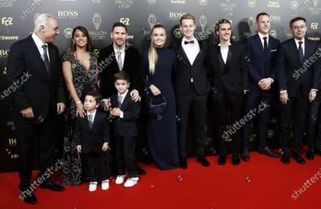 Former Barcelona forward Hristo Stoichkov (L) and Barcelona president Josep Maria Bartomeu (R) arrive with players Lionel Messi (3-L), his wife Antonella Roccuzzo (2-L) and their children Thiago (front R) and Mateo, Frenkie de Jong (4-R) and his girlfriend Mikky Kiemeney, Antoine Griezmann (3-R) and goalkeeper Marc Andre Ter Stegen (2-R) for the Ballon d'Or ceremony at Theatre du Chatelet in Paris, France, 02 December 2019.