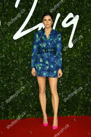 Lilah Parsons poses for photographers upon arrival at the British Fashion Awards in central London