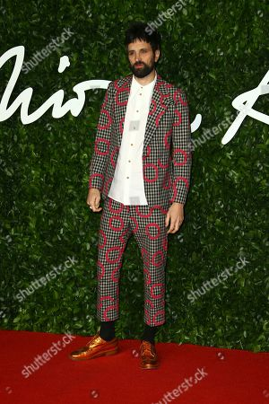 Serge Pizzorno poses for photographers upon arrival at the British Fashion Awards in central London