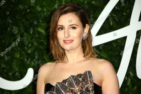 Laura Carmichael poses for photographers upon arrival at the British Fashion Awards in central London