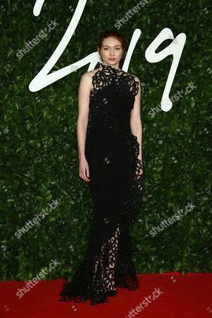 Eleanor Tomlinson poses for photographers upon arrival at the British Fashion Awards in central London