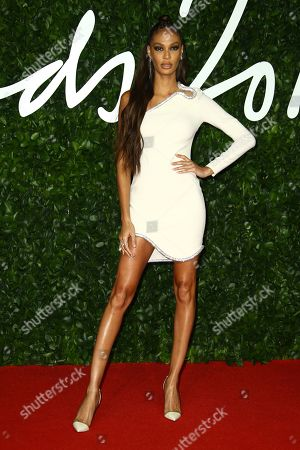 Joan Smalls poses for photographers upon arrival at the British Fashion Awards in central London