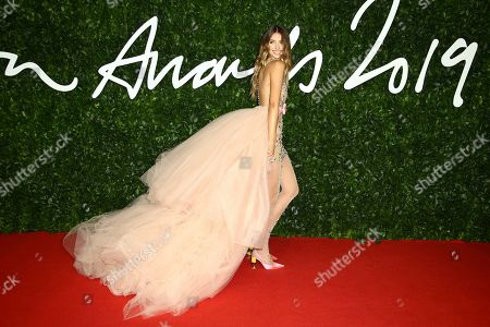Lorena Rae poses for photographers upon arrival at the British Fashion Awards in central London