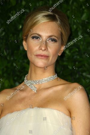 Poppy Delevingne poses for photographers upon arrival at the British Fashion Awards in central London