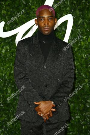 Tinie Tempah poses for photographers upon arrival at the British Fashion Awards in central London
