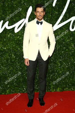 David Gandy poses for photographers upon arrival at the British Fashion Awards in central London