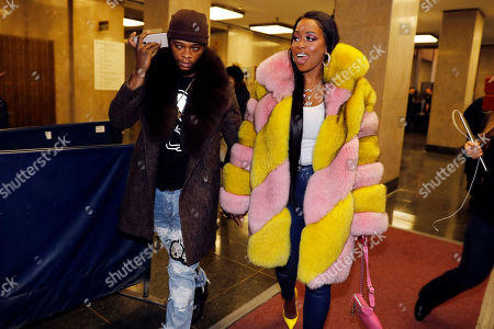 "Stock Photo of Rapper Remy Ma, whose real name is Reminisce Smith, leaves Manhattan criminal court, with her husband Shamele Mackie, whose stage name is Papoose, in New York, . She's accused of punching her ""Love & Hip Hop New York"" co-star Brittney Taylor in the face during an April 16 concert at Irving Plaza, in Manhattan"