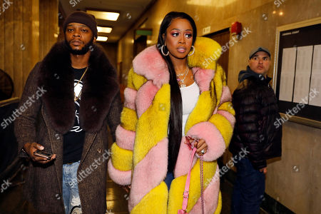 "Rapper Remy Ma, whose real name is Reminisce Smith, leaves Manhattan criminal court, with husband Shamele Mackie, whose stage name is Papoose, in New York, . She's accused of punching her ""Love & Hip Hop New York"" co-star Brittney Taylor in the face during an April 16 concert at Irving Plaza, in Manhattan"