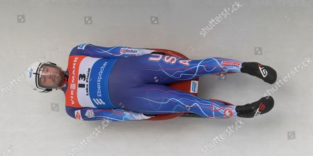 Chris Mazdzer, of the United States, takes a curve during the men's World Cup luge event in Lake Placid, N.Y., on