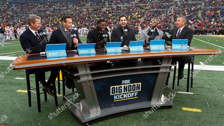 Stock Photo of Fox Sports host Rob Stone, from left, and analysts Brady Quinn, Reggie Bush, Matt Leinart, Heisman Trophy winner Charles Woodson and former Ohio State coach Urban Meyer appear before an NCAA college football game between Michigan and Ohio State in Ann Arbor, Mich