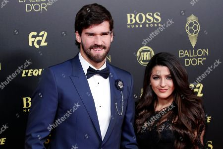 Liverpool's goalkeeper Alisson Becker poses with his wife Natalia Loewe during the Golden Ball award ceremony at the Grand Palais in Paris,. Awarded every year by France Football magazine since Stanley Matthews won it in 1956, the Ballon d'Or, Golden Ball for the best player of the year will be given to both a woman and a man