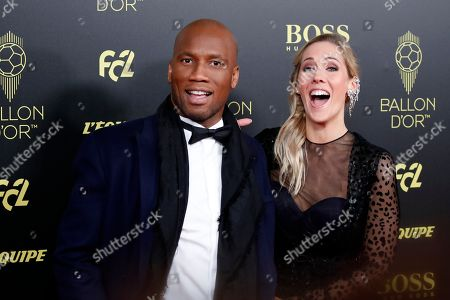 Former soccer star Didier Drogba poses during the Golden Ball award ceremony at the Grand Palais in Paris,. Awarded every year by France Football magazine since Stanley Matthews won it in 1956, the Ballon d'Or, Golden Ball for the best player of the year will be given to both a woman and a man