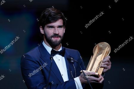 Liverpool's Alisson Becker holds the Yachine Trophy after he awarded as the best goalkeeper during the Golden Ball award ceremony at the Grand Palais in Paris,. Awarded every year by France Football magazine since Stanley Matthews won it in 1956, the Ballon d'Or, Golden Ball for the best player of the year will be given to both a woman and a man