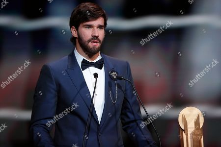 Liverpool's Alisson Becker speaks after he awarded as the best goalkeeper during the Golden Ball award ceremony at the Grand Palais in Paris,. Awarded every year by France Football magazine since Stanley Matthews won it in 1956, the Ballon d'Or, Golden Ball for the best player of the year will be given to both a woman and a man