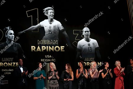 US Megan Rapinoe is seen on the screen after she awarded as the best female soccer player during the Golden Ball award ceremony at the Grand Palais in Paris,. Awarded every year by France Football magazine since Stanley Matthews won it in 1956, the Ballon d'Or, Golden Ball for the best player of the year will be given to both a woman and a man