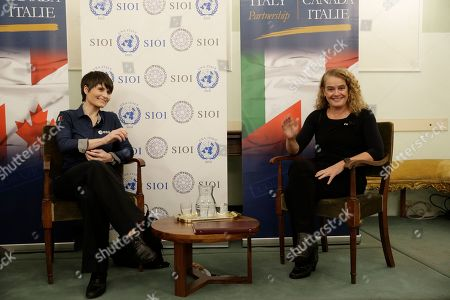 Canada's General Governor Julie Payette, right, and Italian astronaut Samantha Cristoforetti take part in a discussion on space and science diplomacy, in Rome