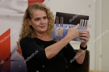 Stock Image of Canada's General Governor Julie Payette shows a photo of the International Space Station as she takes part with Italian astronaut Samantha Cristoforetti in a discussion on space and science diplomacy, in Rome
