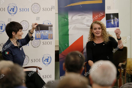 Canada's General Governor Julie Payette and Italian astronaut Samantha Cristoforetti show photos of the International Space Station as they take part in a discussion on space and science diplomacy, in Rome