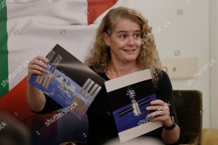 Canada's General Governor Julie Payette shows a photo of the International Space Station as she takes part with Italian astronaut Samantha Cristoforetti in a discussion on space and science diplomacy, in Rome