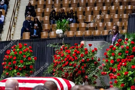 """Pastor J. D. Ruffin Jr., of Mars Hill Missionary Baptist Church, gives the eulogy during the memorial service for slain Lowndes County Sheriff """"Big John"""" Williams, in Montgomery, Ala"""