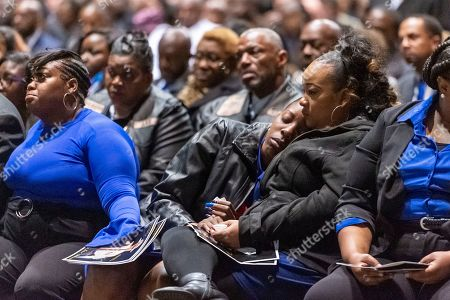 """The family is comforted after the casket was closed during the memorial service for slain Lowndes County Sheriff """"Big John"""" Williams, in Montgomery, Ala"""