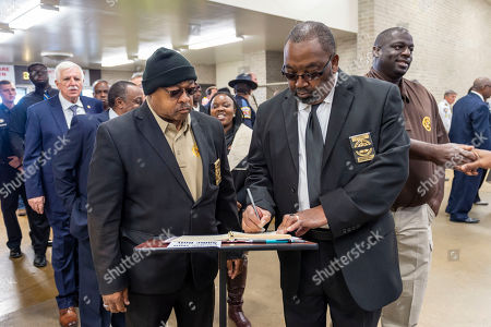 """Sheriff E. I. Evans, of Wilcox County, Ala., signs the register during the memorial service for slain Lowndes County Sheriff """"Big John"""" Williams, in Montgomery, Ala"""