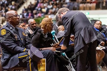 """U.S. Senator Doug Jones gives the U.S. flag that flew over the Capitol to salute the service of Sheriff """"Big John"""" Williams to Williams' wife, Joann Williams, during the memorial service for the slain Lowndes County Sheriff, in Montgomery, Ala"""
