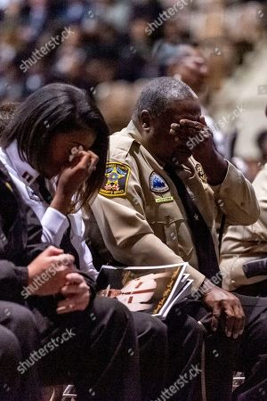"""Members of the Lowndes County Sheriff's office are overcome with emotion as the 'end of watch' is dispatched over the air, ending the memorial service for slain Lowndes County Sheriff """"Big John"""" Williams, in Montgomery, Ala"""