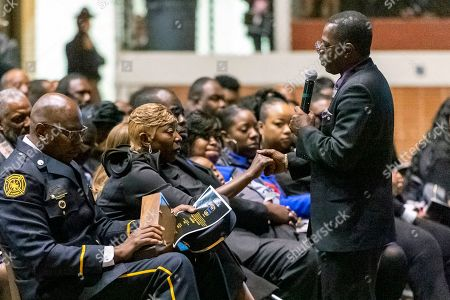 """Pastor J. D. Ruffin Jr., of Mars Hill Missionary Baptist Church, greets Joann Williams, widow of """"Big John"""" Williams, as he gives the eulogy during the memorial service for the slain Lowndes County Sheriff, in Montgomery, Ala"""