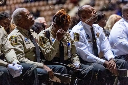 """Stock Image of Members of the Lowndes County Sheriff's office are overcome with emotion as the 'end of watch' is dispatched over the air, ending the memorial service for slain Lowndes County Sheriff """"Big John"""" Williams, in Montgomery, Ala"""