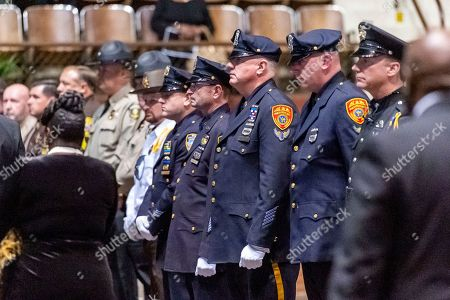 """Stock Photo of Members of multiple emergency service departments stand in respect for the departing family and friends, following the memorial service for slain Lowndes County Sheriff """"Big John"""" Williams, in Montgomery, Ala"""