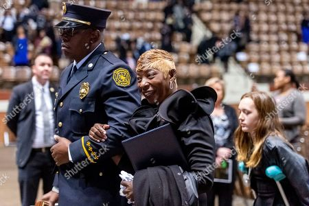 """Joann Williams, widow of slain Lowndes County Sheriff """"Big John"""" Williams, smiles at a friend as she departs the memorial service for her husband, in Montgomery, Ala"""