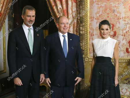 Spanish King Felipe VI (L) and Queen Letizia (R) welcome Prince Albert II of Monaco (C) upon arrival at a reception held for heads of states at the Royal Palace in Madrid, Spain, 02 December 2019, on the occasion of the UN Climate Change Conference COP25 that runs from 02 to 13 December 2019 in the Spanish capital.