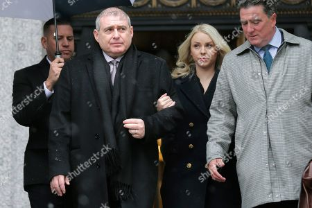 Lev Parnas, second from left, arrives to court in New York, . Parnas and Igor Fruman, close associates to U.S. President Donald Trump's lawyer Rudy Giuliani, were arrested last month at an airport outside Washington while trying to board a flight to Europe with one-way tickets. They were later indicted by federal prosecutors on charges of conspiracy, making false statements to the Federal Election Commission and falsification of records