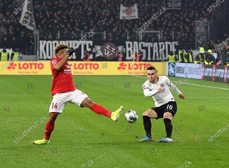 Pierre Kunde (L) of Mainz in action against Filip Kostic (R) of Frankfurt during the German Bundesliga soccer match between FSV Mainz 05 and Eintracht Frankfurt in Mainz, Germany, 02 December 2019.