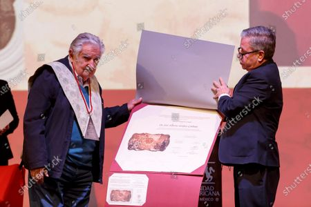 The former president of Uruguay Jose Mujica (L), receives the Honorary Doctorate awarded by the rector of the Universidad Iberoamericana, David Fernandez (R), during an event held in Mexico City, Mexico, 02 December 2019.