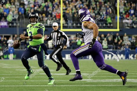 Anthony Barr, Russell Wilson. Seattle Seahawks quarterback Russell Wilson (3) scrambles as Minnesota Vikings' Anthony Barr approaches during the first half of an NFL football game, in Seattle