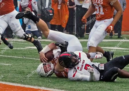 Sam Ehlinger, Douglas Coleman, III. Texas quarterback Sam Ehlinger, back, is upended by Texas Tech's Douglas Coleman, III, front, during the first half of an NCAA college football game, in Austin, Texas
