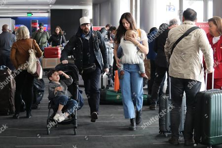 Stock Picture of Adam Goldberg and Roxanne Daner with children Bud and Mazel