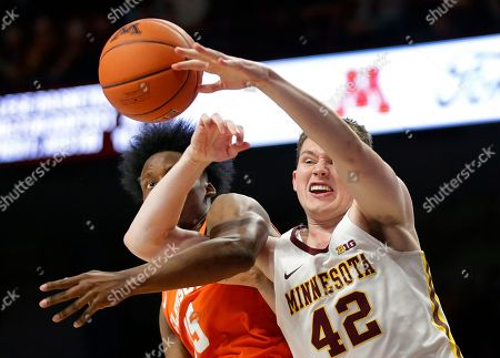 Minnesota forward Michael Hurt (42) and Clemson forward John Newman III (15) battle for a rebound in the second half during an NCAA basketball game, in Minneapolis