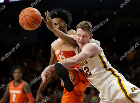 Minnesota forward Michael Hurt (42) and Clemson forward John Newman III (15) battle for a rebound in the second half during an NCAA college basketball game, in Minneapolis