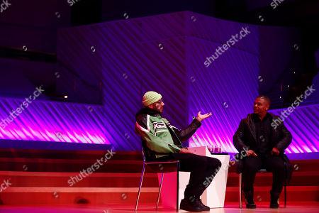 Kehinde Wiley, Swizz Beatz. Kehinde Wiley, right, and Swizz Beatz speak during Art Basel, in Miami Beach, Fla