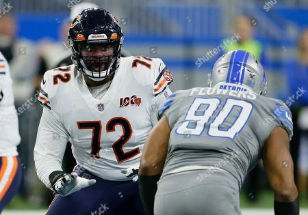 Chicago Bears offensive tackle Charles Leno (72) blocks Detroit Lions defensive end Trey Flowers (90) during the first half of an NFL football game, in Detroit