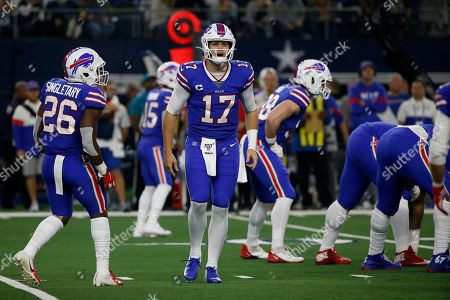 Buffalo Bills' Josh Allen signals the line of scrimmage as running back Devin Singletary (26) looks on during an NFL football game against the Dallas Cowboys in Arlington, Texas