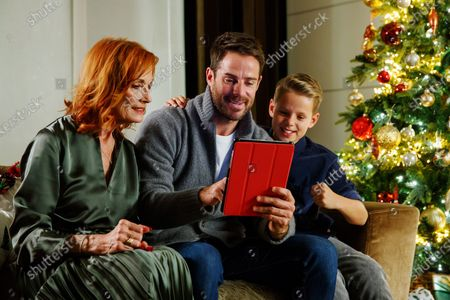 Jamie Redknapp, mother Sandra Redknapp and son test out a new game from Vodafone's reward scheme