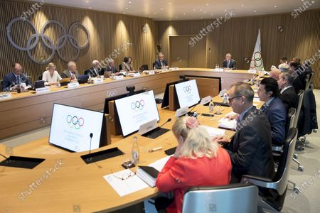 International Olympic Committee (IOC) president Thomas Bach (back, C-R) of Germany speaks with IOC members at the opening of the executive board meeting of the IOC at the Olympic House in Lausanne, Switzerland, 03 December 2019.