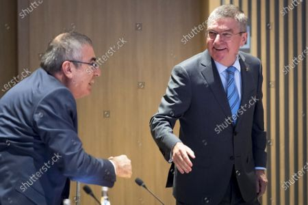 International Olympic Committee (IOC) president Thomas Bach (R) of Germany speaks with IOC member Ugur Erdener (L) of Turkey at the opening of the executive board meeting of the IOC at the Olympic House in Lausanne, Switzerland, 03 December 2019.