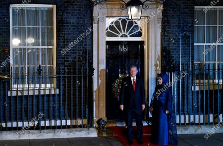 Turkish President Recep Tayyip Erdogan (L) and his wife Emine arrive at 10 Downing Street for a reception during the NATO Summit in London, Britain, 03 December 2019. NATO countries' heads of states and governments gather in London for a two-day meeting.