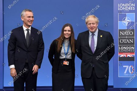 Prime Minister of Iceland Katrin Jakobsdottir(C) poses with British Prime Minister Boris Johnson (R) and Nato Secretary General Jens Stoltenberg during the NATO Summit in London, Britain, 04 December 2019. NATO countries' heads of states and governments gather in London for a two-day meeting.
